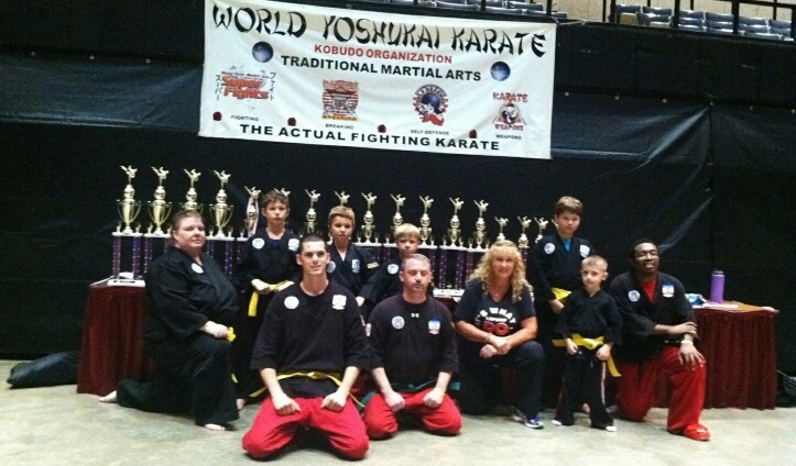 Picture of competitors posing with trophies